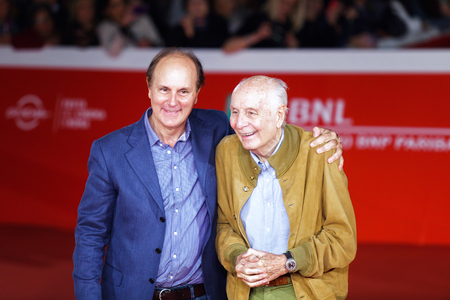 arts culture and entertainment: Rome, Italy - October 16, 2016: Folco Quilici and Brando Quilici (L) walk a red carpet for The Rolling Stone Ole Ole Ole!: A trip Across Latin America during the 11th Rome Film Festival at Auditorium Parco Della Musica