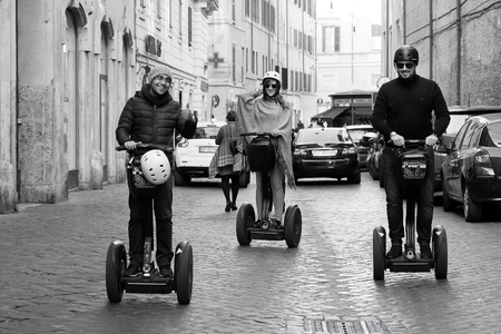 segway: Rome, Italy - November 27, 2016: Boys Segway through the narrow streets of central Rome. Editorial