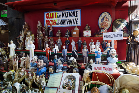 statuettes: Naples, Italy - December 9, 2016: Statuettes handmade representatives famous celebrities, sports, politics, music and religion. Stand facing San Gregorio Armeno, street famous for the sale of nativity scenes and religious statues and celebratory.
