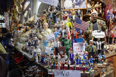 statuettes: Naples, Italy - December 9, 2016: Painted statuettes handmade representatives famous celebrities, sports, politics, music and religion. Stand facing San Gregorio Armeno, street famous for the sale of nativity scenes and religious statues and celebratory. Editorial