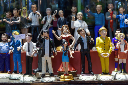 statuettes: Naples, Italy - December 9, 2016: San Gregorio Armeno, painted statuettes handmade representatives famous celebrities, sports, politics, music and religion. Editorial