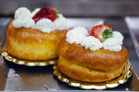 Two babas with white cream and strawberries, ready to be tasted. typical Neapolitan pastry, known throughout the world.