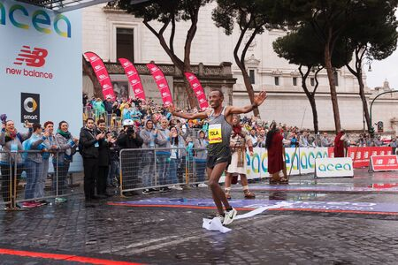 beaming: Rome, Italy - April 2, 2017: Tola Shura Kitata is the winner of the mens race of 23 ^ Rome Marathon. Tola arrival on the finish line. Editorial