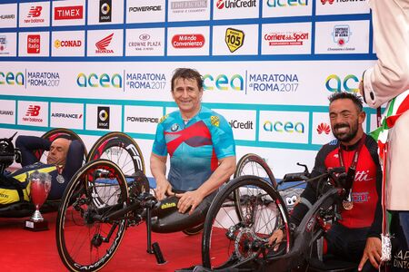 Rome, Italy - April 2, 2017: Alex Zanardi is the winner of the hand bike race of 23 ^ Rome Marathon. On stage together for the second place, Cratassa Mauro (left) and third prize Giagnoni Christian. Editorial