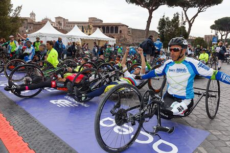 physical impairment: Rome, Italy - April 2nd, 2017: Athletes with hand bikes are prepared before departure at the 23rd Marathon of Rome, in Via dei Fori Imperiali. Editorial