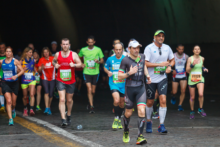 Rome, Italy - April 2nd, 2017: Athletes of the 23rd Rome Marathon to the passage of the tunnel Umberto I, a few kilometers from the finish.