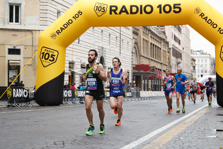 Rome, Italy - April 2, 2017: Athletes of the 23rd Marathon of Rome at the passage in Via Nazionale, a few kilometers from the finish line. Editorial
