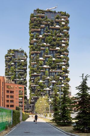 confines: Milan, Italy - June 11, 2017: The famous Vertical Wood, a sustainable residential building model, consisting of two residential towers of 110 and 76 m high, built in the center of Milan at the confines of the Isola district.