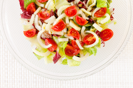 Top view, mixed salad in glass dish and white background. Raw food. Stock Photo