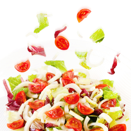 Mixed salad in glass dish and white background. Raw food.