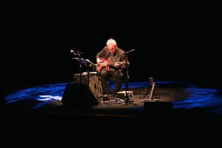 Rome, Italy - January 18, 2018: The American guitarist Marc Ribot performs in a solo on the stage of the Auditorium Parco della Musica. Ribot uses both the classical guitar and the electric guitar.