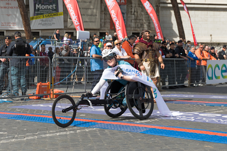 Rome, Italy - 8 April 2018: Margriet Van Den Broek winner of the 24th edition of the Rome Marathon and Run for Fun in the women wheelchair category. Margriet Van Den Broek upon arrival at the finish line.