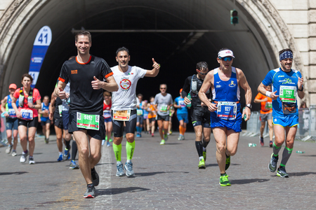 Rome, Italy - 8 April 2018: Athletes taking part in the 24th edition of the Rome Marathon and Run for Fun at the Umberto I tunnel, when one kilometer is missing at the finish line.