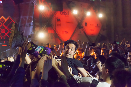 Rome, Italy - May 01, 2018: Cosmo performs on the stage of the concert of the first of May, in Piazza San Giovanni. The Italian singer incites the public in the square and at the end launches in a stage diving between the fans. Credit: Gennaro LeonardiAl