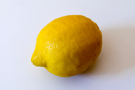 lemon photographed in the studio on a white background. whole lemon fruit. Stock Photo