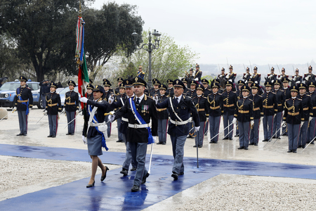 Rome, Italy - April 10, 2019: the police line-up with the Italian flag, during the celebrations of the 167th anniversary of the State Police, held at the Pincio in Rome. Editorial
