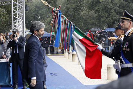 Rome, Italy - April 10, 2019: The president of the Chamber of Deputies Roberto Fico honors the Italian flag during the celebrations for the 167th anniversary of the State Police, held at the Pincio in Rome.