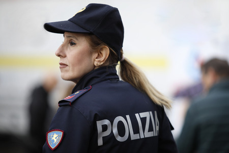 Rome, Italy - April 14, 2019: Piazza San Giovanni Bosco, a policewoman in the road department wearing the classic cap, during the celebrations for the 167th anniversary of the Police. Standard-Bild - 122153306
