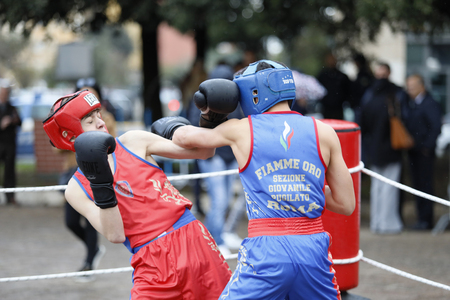 Rome, Italy - April 14, 2019: Piazza San Giovanni Bosco, young athletes from the sports department perform a boxing match during the celebrations for the 167th anniversary of the Police. 報道画像