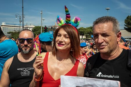 Rome, Italy - 8 June 2019: Vladimir Luxuria, a former parliamentarian and attending the Gay Pride event, in the square in Rome. Luxuria photographed in the company of two men. Redactioneel