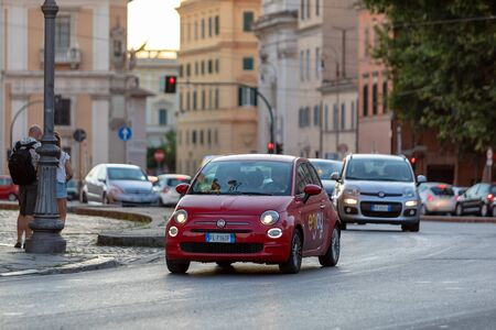 Rome, Italy - August 18, 2019: a typical rental car of the Enjoy circuit circulates in the streets of the center of the capital. Transport and sustainable mobility in the city. Editöryel