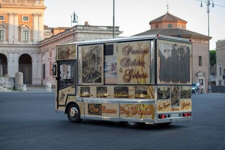 Rome, Italy - August 18, 2019: Van for food and beverage sales on the move. Van decked with tourist images of the city.