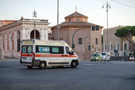Rome, Italy - August 18, 2019: Ambulance transports sick to the hospital. Inside the patient and nurse are visible. Public health emergency.