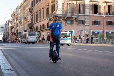 Rome, Italy - August 15, 2019: A man circulates on an electric unicycle on the streets of the city center. Electric vehicle, sustainable mobility of people. Innovative urban transport. Editöryel