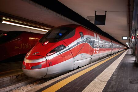 Naples, Italy - September 07, 2019: two high-speed trains of different transport companies, stopped on the platform of the central railway station. Editöryel