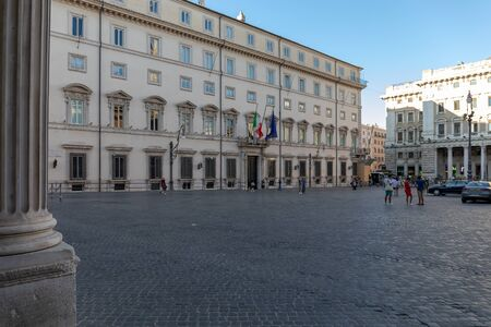 Rome, Italy - August 15, 2019: Palazzo Chigi, institutional seat of the Italian government. The main entrance with the building facade and flags. Piazza Colonna, in front of the building. Editöryel