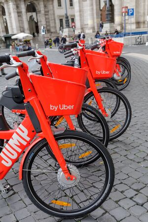 Rome, Italy - November 5, 2019: Electric rental bikes in Piazza della Repubblica. Uber Jump, the electrically assisted bike-sharing rental service for getting around the city starts for the first time in the capital.