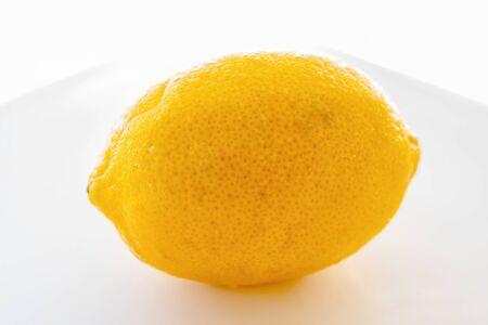 Lemon fruit foreground on a white background. Whole lemon, studio macro photography. Stok Fotoğraf