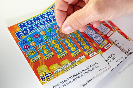 Rome, Italy - December 1, 2019: scratch card lottery, fortune ticket. scratch the lucky numbers with the coin. Illustrative editorial