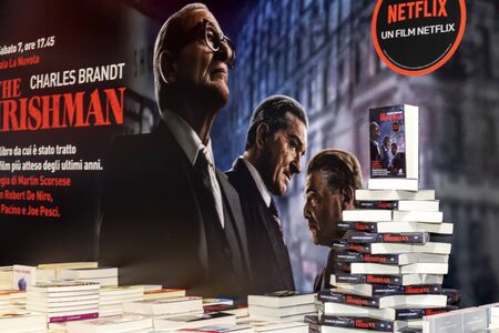 Rome, Italy - December 5, 2019: the book The Irishman by Charles Brandt from which Martin Scorsese took the eponymous film masterpiece, exhibited during the fair of small and medium publishing