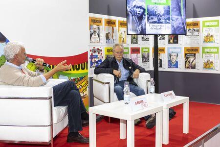 Rome, Italy - December 5, 2019: The writer Erri De Luca conversing with Gregorio Botta inside the Arena Robinson. At the small and medium publishing fair