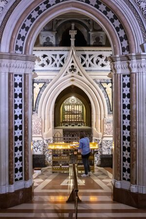 Assisi, Italy - December 7, 2019: Inside the church there is the original crypt with the remains of St. Clare, enclosed in a body-reliquary, which lies inside a crystal urn.