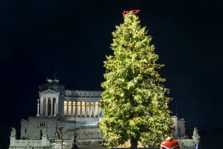 Rome, Italy - December 14, 2019: Piazza Venezia set up for Christmas. At the center stands the large pine decorated with Christmas decorations, lights and Christmas balls. Editöryel