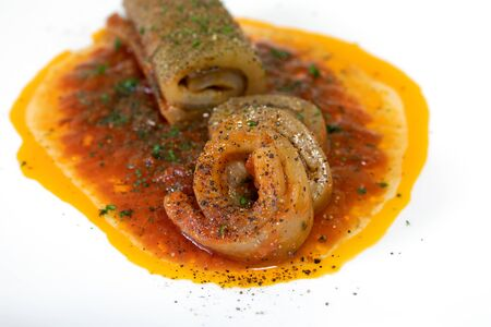 Pork skin roulade, stuffed with garlic, parsley and pepper, cooked in tomato sauce. Typical dish of traditional Italian cuisine. Pork roulade, ready to eat. Stok Fotoğraf