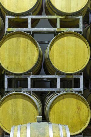 Oak barrels for aging the wine in the cellar. Barrels for the fermentation of wine inside a farm. Stok Fotoğraf