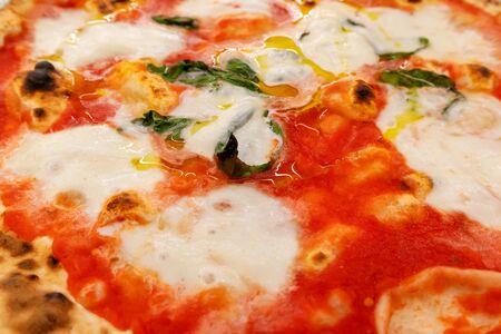 Close-up of classic Pizza Margherita, Italian restaurant menu.