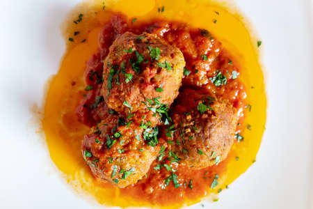 Succulent minced meatballs cooked in tomato sauce. Ready-to-eat dish. Italian cuisine.
