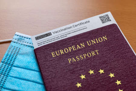 COVID-19 Vaccination Record card whith QR Code, Passport of Europe and Medical Mask. Immune passport or certificate for travel concept.