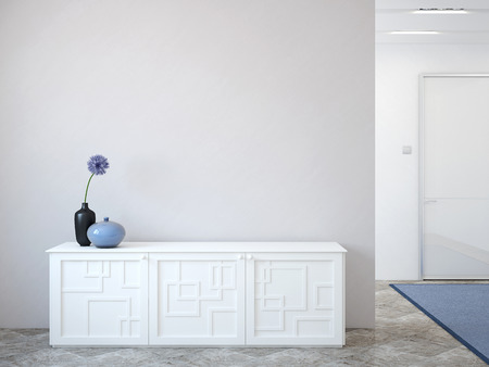 commode: Modern hallway with commode near empty gray wall.