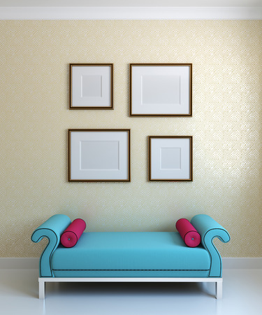 footstool: Interior.Blue ottoman with crimson pillow and emty frames on the wall Stock Photo