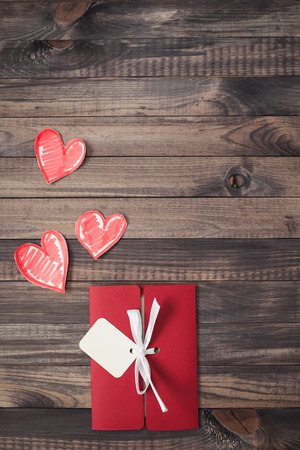 romance: Romantic red envelope on a wooden background Valentines Day