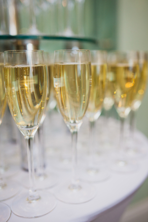 Closeup of wineglasses with sparkling wine at the wedding party. Selective focus. Ideas for decoration Banco de Imagens