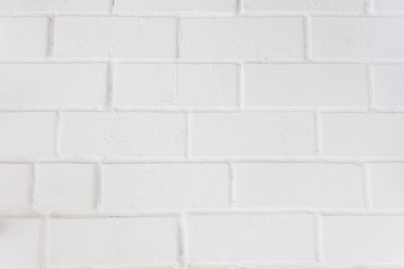 Neat white painted brick wall with a distinct texture Stock Photo