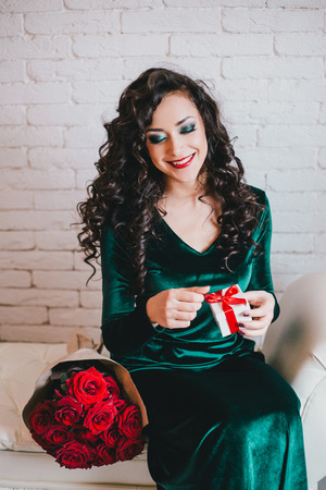 velvet dress: Woman with red lipstick in green velvet dress and red shoes with red roses and gift collage.