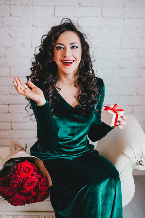 velvet dress: Woman with red lipstick in green velvet dress and red shoes with red roses and gift collage. Valentines Day