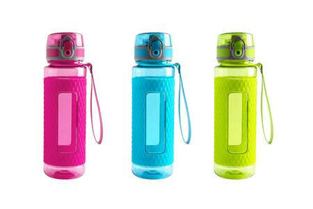 Three different bright green, blue and pink plastic and rubber fitness sport bottles or flasks with dispenser and water on isolated white background. Sport thirst and hydration concept